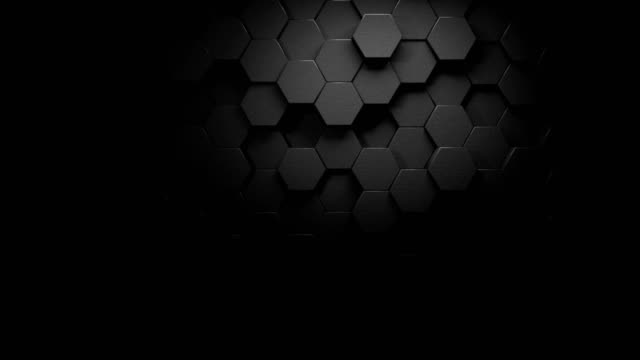 vídeos de stock e filmes b-roll de beautiful dark gray hexagons on surface morphing with a strong lighting in seamless 3d animation, abstract motion design background 4k video - honeycomb