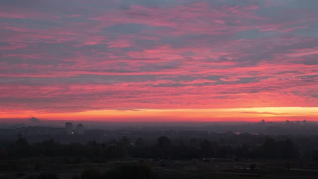 Beautiful dawn over the city, the fog moves above the ground Beautiful dawn over the city, the fog moves above the ground horizon over land stock videos & royalty-free footage