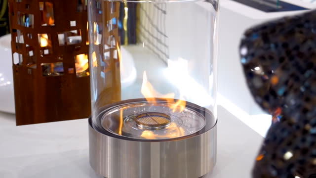 Beautiful decorative, chrome with glass, cylindrical lamp with fire video