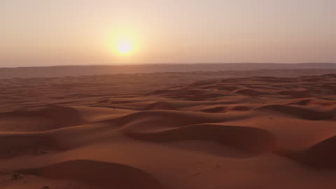 AERIAL Beautiful desert at sunset Drone shot of beautiful sand dunes in the desert in Oman at sunset. Arabian Peninsula. middle east stock videos & royalty-free footage