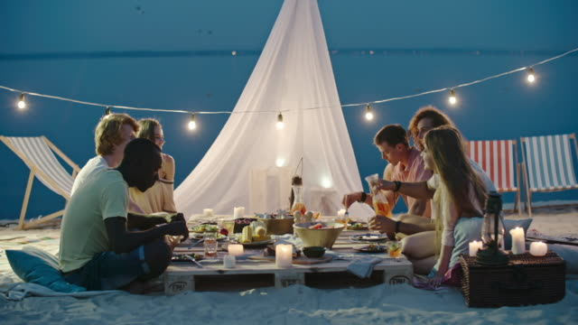 Beautiful Dinner on the Beach with Friends - video