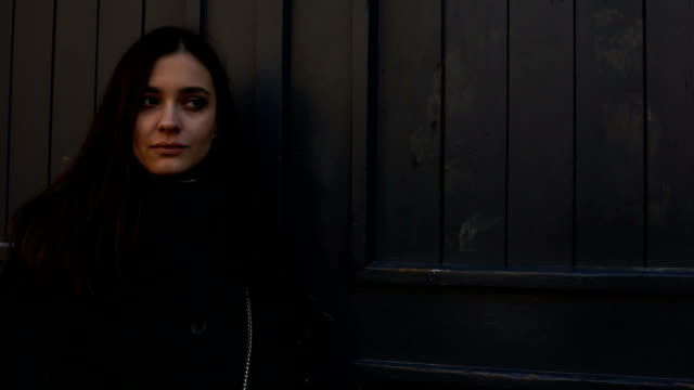 Beautiful disappointed girl waiting outside for boyfriend who is late for date Beautiful disappointed girl waiting outside for boyfriend who is late for date human trafficking stock videos & royalty-free footage