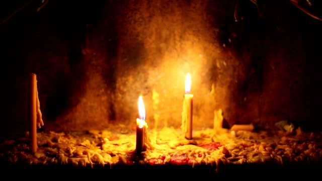 Beautiful dramatic candle lights and melting wax video