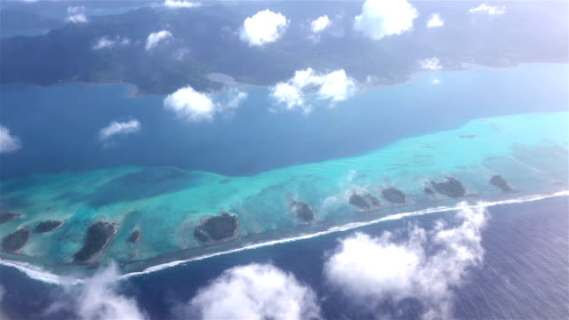 4K AERIAL: Beautiful dreamy Bora Bora atoll island with white sand reef around the main island. Flying above French Polynesia for exotic summer vacation. video