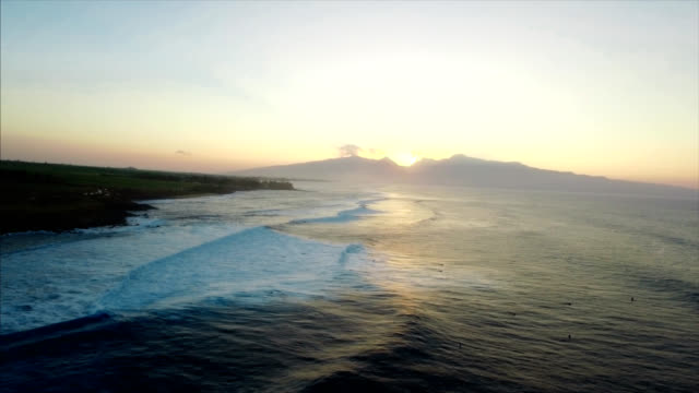 Beautiful drone shot reveal of Maui coastline as the sun is setting video