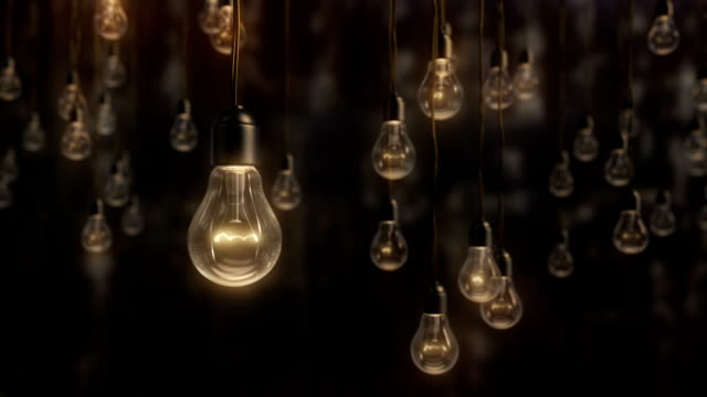 Beautiful edison style light bulbs against black wall background video