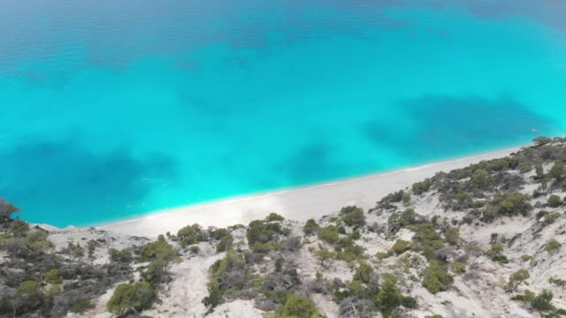Beautiful  Egremni beach, aerial view of a rocky cliffs and waves Famous Egremni beach, aerial view of a rocky cliffs and waves crashing at the sandy beach, Lefkada Greece 天の川 stock videos & royalty-free footage