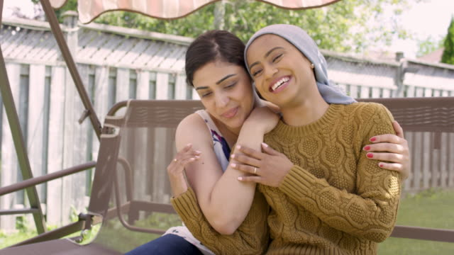 beautiful ethnic female with cancer embracing her sister - cancer patient stock videos & royalty-free footage