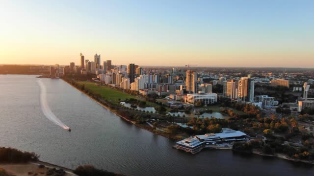 beautiful evening aerial drone footage of the city of perth, western australia, right before sunset. speed boad on the river in the foreground and langley park behind. perth is the capital city of wa. - western australia stock videos & royalty-free footage