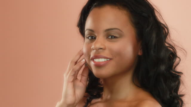 Beautiful exotic woman on peach bg  red lipstick stock videos & royalty-free footage