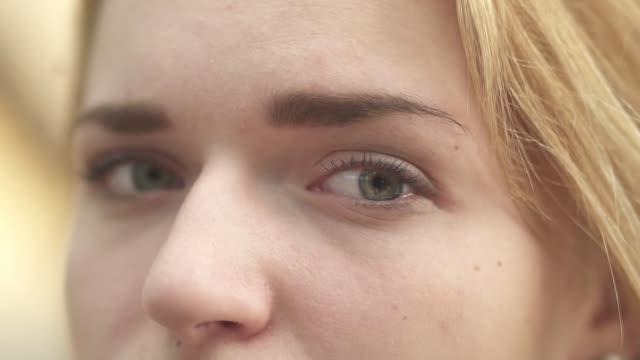 beautiful eyes of a young girl close-up - pesche bambino video stock e b–roll