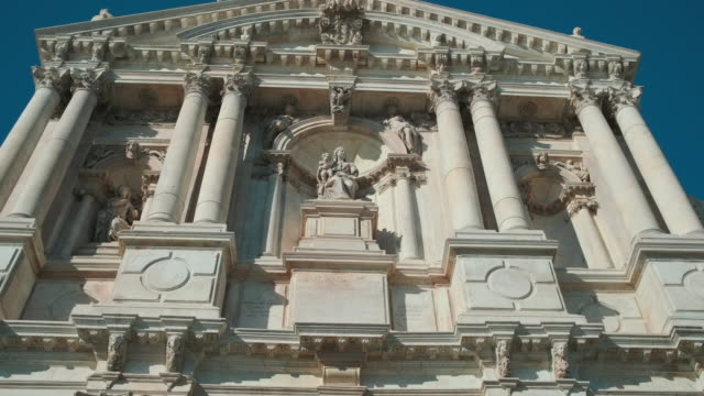 Beautiful facade of an Italian basilica, gothic style. Architectural tour in a Venice, field trip Beautiful facade of an Italian basilica, gothic style. Architectural tour in a Venice, field trip. neo gothic architecture stock videos & royalty-free footage