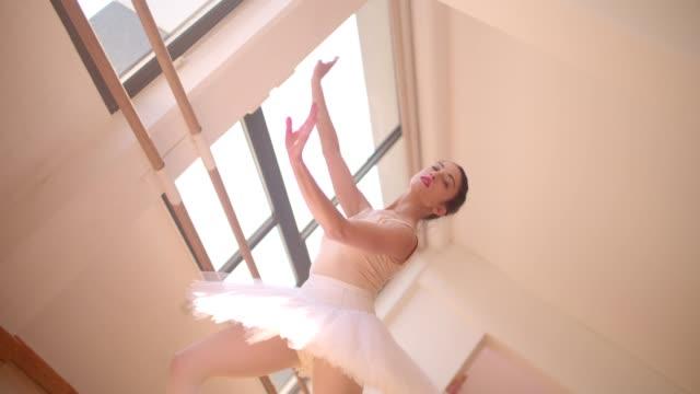 Beautiful female ballet dancer dancing in ballet studio video