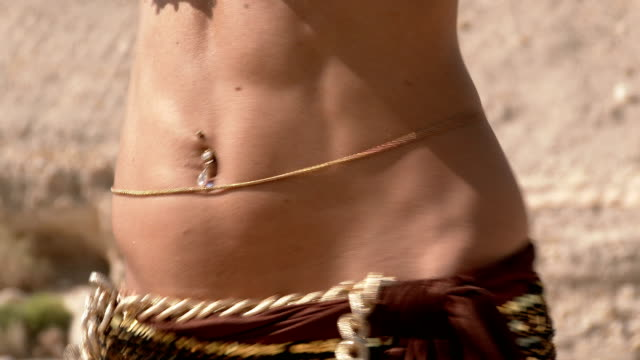 Beautiful female dancer. Belly dance. Desert. Sexy golden brown dress dancing. Close up. video