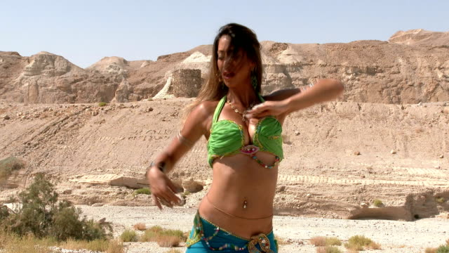 beautiful female dancer. belly dance. desert. sexy green blue dress dancing - belly dancing stock videos and b-roll footage