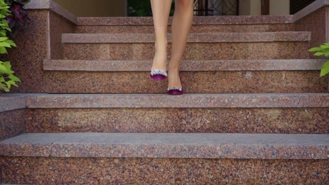 Beautiful female legs on a city street Beautiful female legs on a city street. Female feet walk the streets of the city. Beautiful girl in the city. seductive women stock videos & royalty-free footage
