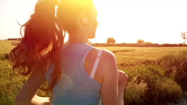 Beautiful Female Model Running Sunset Flare Slow Motion video