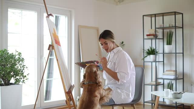 Beautiful female painter working video