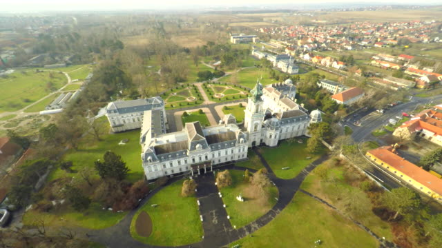 AERIAL Beautiful Festetics Palace Aerial shot of the Festetics Palace located with the town of Keszthely in the background. Hungary. Europe. hungary stock videos & royalty-free footage