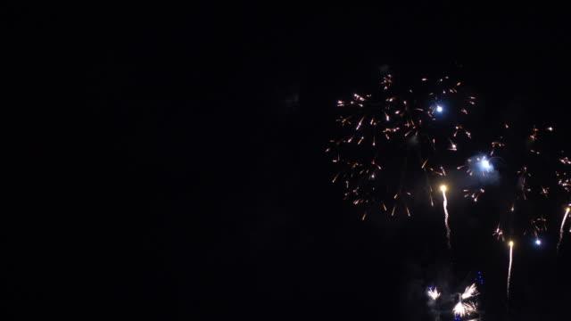 beautiful firework display celebration on black and dark sky background - happy 4th of july filmów i materiałów b-roll