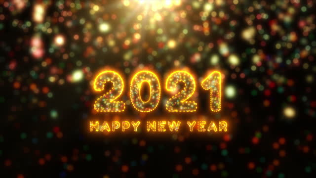 Beautiful Fireworks and bokeh of 2021 Happy New Year greeting text with particles and sparks. Holiday and celebration background concept. Beautiful Fireworks and bokeh of 2021 Happy New Year greeting text with particles and sparks. Holiday and celebration background concept. happy new year 2021 stock videos & royalty-free footage