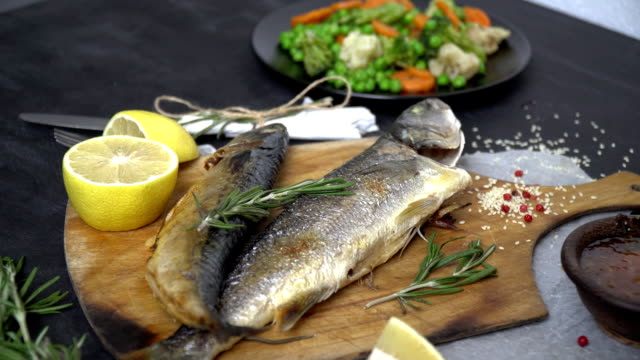 A beautiful fish dish with vegetables and greens around video