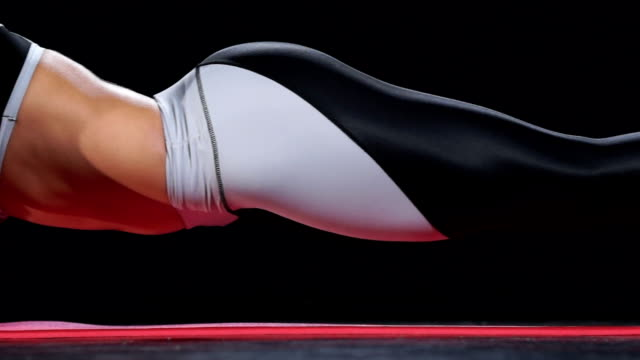 Beautiful fit girl in plank position video
