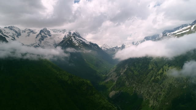 beautiful flight in the clouds surrounded by high mountains. - monte bianco video stock e b–roll