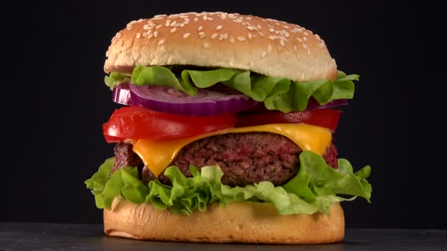 beautiful fresh burger rotate on turntable - burgers stock videos and b-roll footage