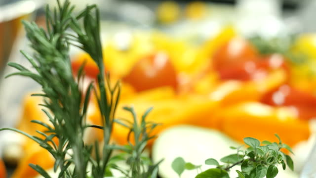 Beautiful fresh vegetables lie on the table in the kitchen video