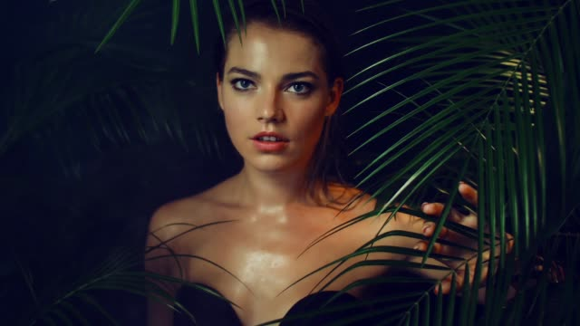 beautiful girl among tropical plants. - woman portrait forest video stock e b–roll