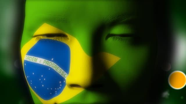 beautiful girl brazilian flag face painted - brasilien flagga bildbanksvideor och videomaterial från bakom kulisserna