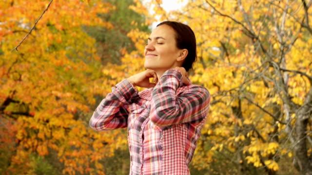 Beautiful girl breathing in autumn park video