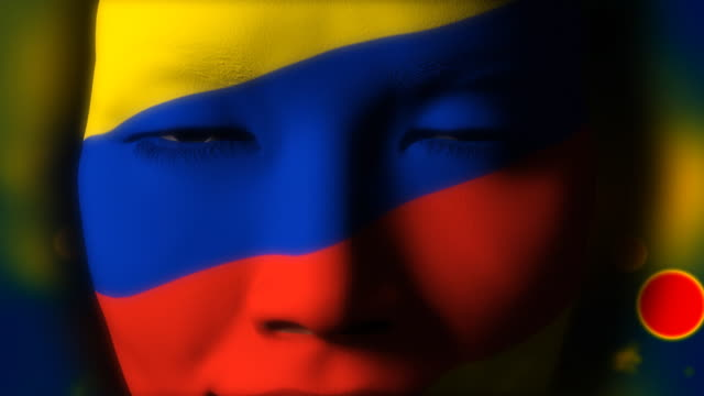 Beautiful girl COLOMBIAN flag face painted video