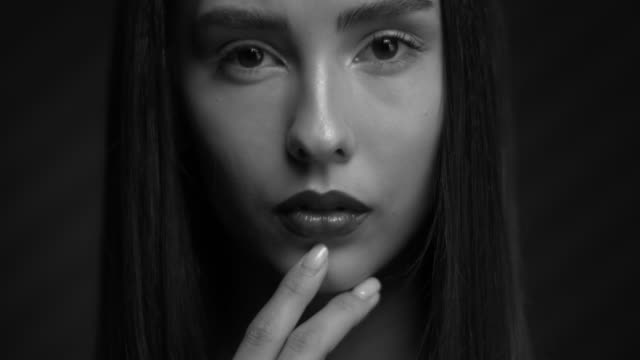 Beautiful girl in black and white with painted lips and a manicure. video