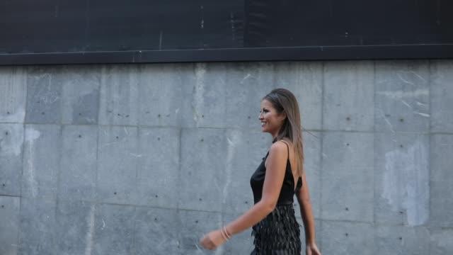 Beautiful girl in black dress Fashion model in long black dress walking and smiling urban fashion stock videos & royalty-free footage