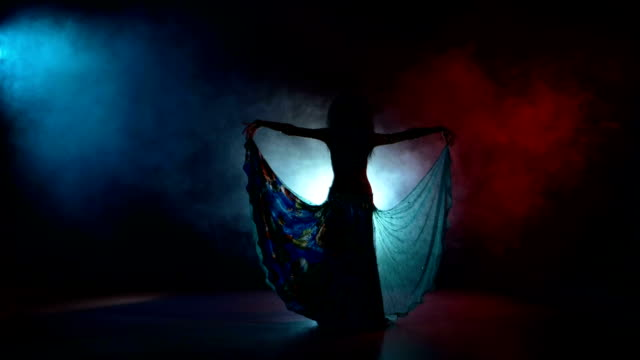 beautiful girl in blue dancing belly dance, on red, blue, smoke,  back light - belly dancing stock videos and b-roll footage