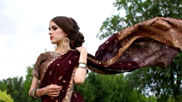 beautiful girl in indian dress sari, outdoors. - wedding fashion stock videos and b-roll footage