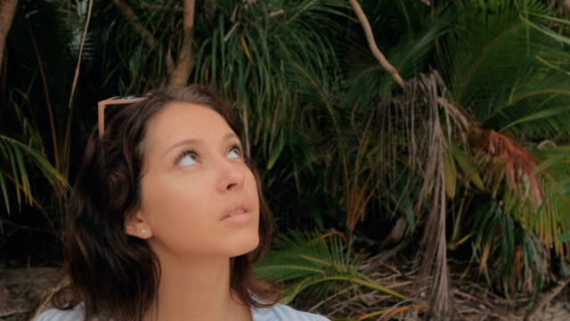 Beautiful girl looking up. woman dreaming looking upwards, Slow Motion video