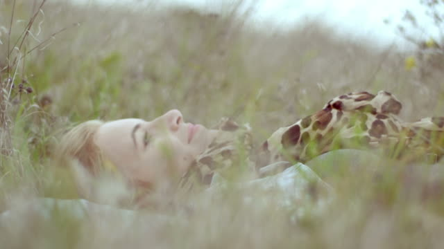 Beautiful girl lying on the meadow video