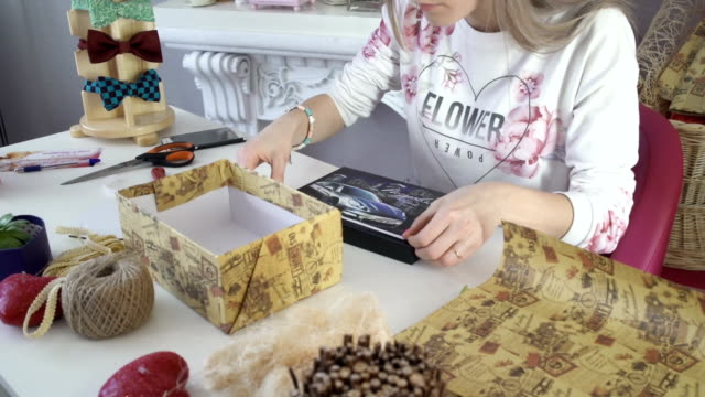 Beautiful girl prepares a wonderful wedding gift with their own hands video