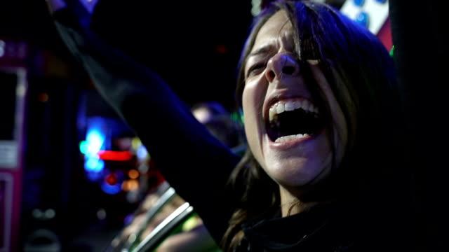 Beautiful girl screaming an laughing in amusement park ride