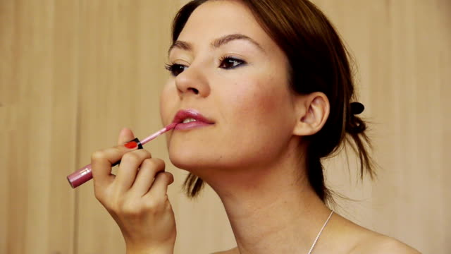Beautiful Girl smiling brightly making up. Using pink lipstick. Beautiful Girl smiling brightly when making up. Using pink lipstick. lip liner stock videos & royalty-free footage