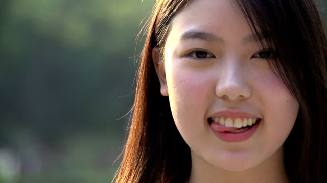 beautiful girl smiling in slowmotion video