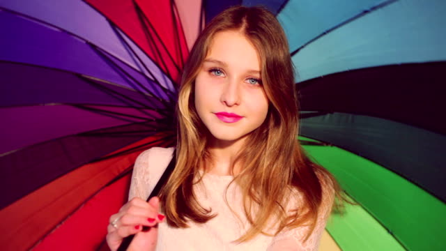 beautiful girl with colorful umbrella video