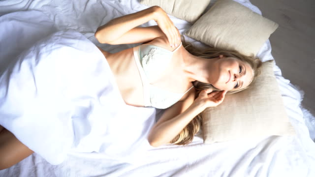 beautiful girl woke up in the morning in his bed video