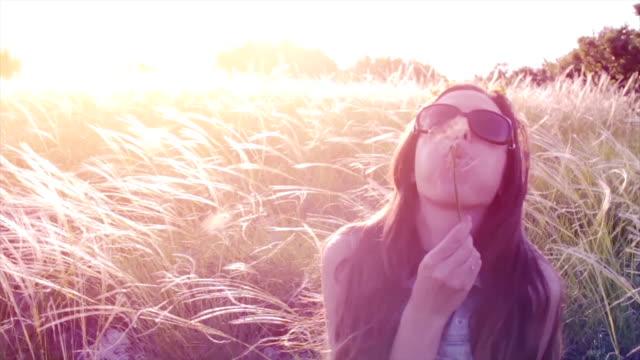 Beautiful Girl Woman Blowing Dandelion at Sunset Beauty video