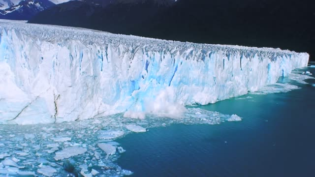 beautiful glacier breaking and falling 4k - clima video stock e b–roll