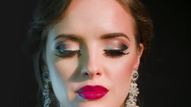 Beautiful glamorous woman Studio portrait of beautiful glamorous woman. Professional make-up and hairstyle. High-end retouch. Slow speed. Source Sony RAW 12 bit. art deco architecture stock videos & royalty-free footage