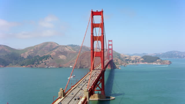 aerial beautiful golden gate bridge in san francisco, california on a sunny day - california video stock e b–roll